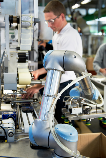 Cobot working with human in factory